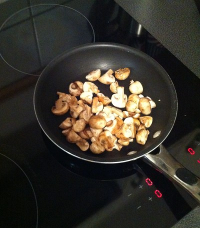 Sautéing the mushrooms...in butter. Mmmm!